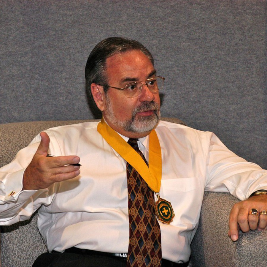 James Kendrick Talking While Wearing a Medal
